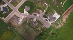 An aerial shot flying over rural neighborhood with big homes Stock Footage