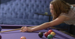 Young business woman taking a shot on pool table 4K Stock Footage