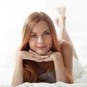 Woman's morning in bed - stock photo