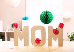 Mom letter blocks with pink carnation flowers Stock Photos