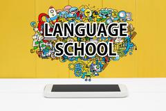 Language School concept with smartphone Stock Photos