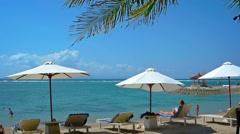 Tourists Enjoying a Tropical Beach Paradise in Sanur, Bali, Indonesia Stock Footage