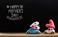 Mothers Day message with pink and blue cars Stock Photos