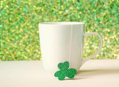 Green clover with white mug Stock Photos