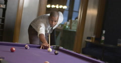 African American business man playing pool in lounge setting 4K Stock Footage