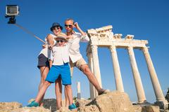 Family take a selfie video on the antique colonnade view Stock Photos