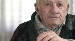 Old man proudly staring straight at the camera - stock footage