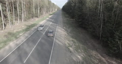 Aerial chase the car from top in dense forest road - stock footage