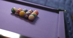 Pool balls breaking on a purple table in slow motion 4K Stock Footage