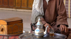 Berber man drinking his tea at home Stock Footage