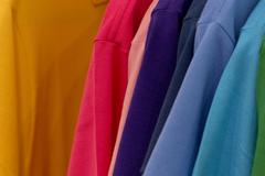 Different colors polo shirt on display stand Stock Photos