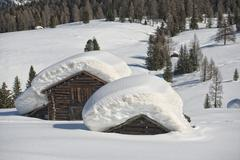 Isolated wood mountain house cabin hut covered by snow - stock photo