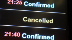 Flight canceled on information board in airport terminal Stock Footage