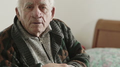 worried, sad, pensive old man in his room - stock footage