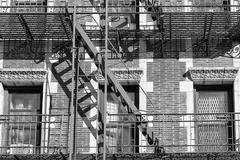 Old Building fire ladder in black and white - stock photo