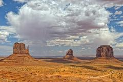 Monument Valley Arizona view with wonderful cloudy sky and lights on mittens Stock Photos