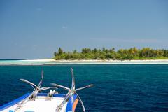 Ship anchor on ocean paradise background Stock Photos