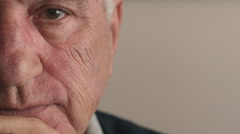 detail of seriuous old man's gaze - stock footage