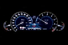 Dashboard and digital display - mileage, fuel consumption, speedometer KPH - stock photo