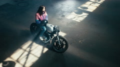 Wide overhead shot of Caucasian male biker having a chat with a girl on a bike Stock Footage