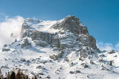 Dolomites huge panorama view in winter snow time - stock photo