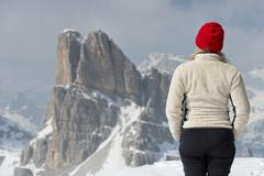 woman contemplating dolomites panorama landscape - stock photo