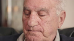pensive pensioner thinks, smoking a cigarette - stock footage