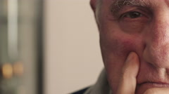 sad and reflective face of pensioner - stock footage
