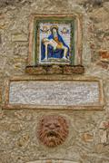 Close up of medieval madonna painting on tuscany village wall Stock Photos