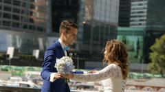 wedding couple dancing in the city - stock footage
