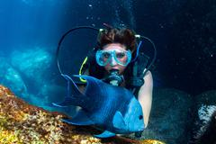 black hair mexican beauty diving in the deep blue sea - stock photo
