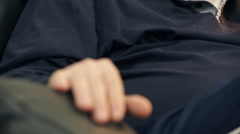 Pensive old man moves his fingers on the chair Stock Footage