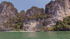 Limestone Seacliffs over the Tropical Andaman Sea in Thailand Stock Footage