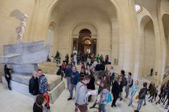 PARIS, FRANCE - APRIL 30, 2016 - Louvre museum crowded of tourist taking pict Kuvituskuvat