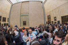 PARIS, FRANCE - APRIL 30, 2016 - lot of people inside louvre museum, taking p - stock photo