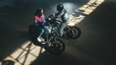 Overhead shot of Caucasian male biker having a chat with a girl on a bike Stock Footage