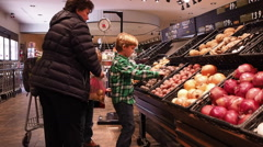 Family Shopping In Local Health Food Store Stock Footage