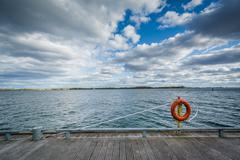 A ring buoy and walkway along Lake Ontario, at the Harbourfront, in Toronto,  Stock Photos