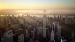 sun beaming light shining over city metropolis at sunset - stock footage