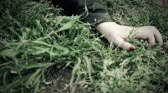 Young woman faints on a lawn Stock Footage
