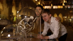 4K Mother & son in natural history museum looking at a skeleton inside glass jar Stock Footage