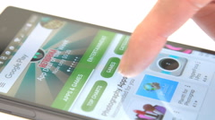 Browsing the Google Play Store on Android smartphone - stock footage