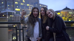 Carefree Teens Pose For Fun Selfies On A Rooftop In The City At Night Arkistovideo