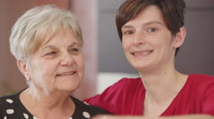 Strong hug between grandmother and her grandaughter Stock Footage