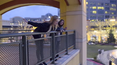 Girl Leans Over Balcony Railing And Pretends To Fly Stock Footage