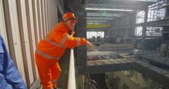 4K Interior view of huge industrial power plant & male & female engineers - stock footage