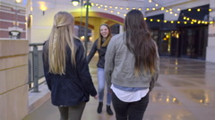 Carefree Teens Dance And Walk Around Outdoor Shopping Mall At Night Stock Footage