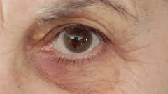 Tired, proud eye of old woman's eye Stock Footage