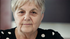 happy old woman smiles to the camera - stock footage