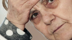Sick old lady looks to the camera Stock Footage